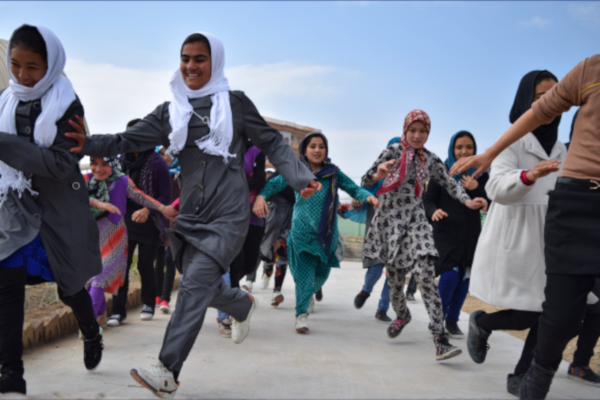 Afghan girls running towards the camera.